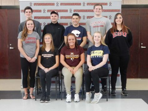 Ten students sign with colleges to continue their athletic careers — See photo gallery
