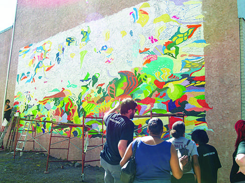 Volunteers work on murals through out the Stroudsburgs at the first-ever street art festival