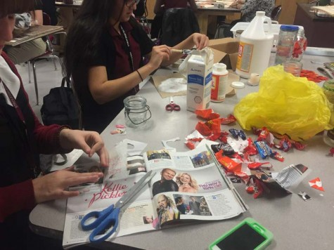 Art Club and Environmental Club work together to create upcycled crafts
