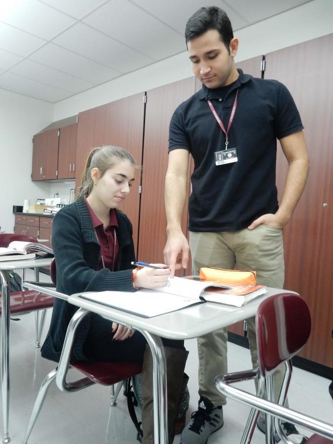 Classmates A.J Sarmiento and Viktoria-Marie Petri study together