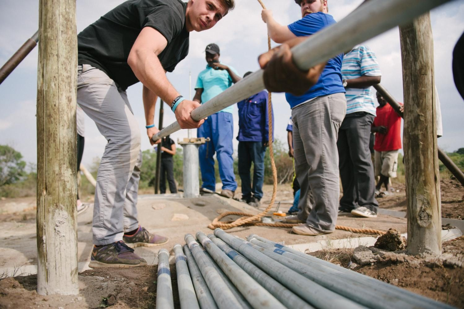 Evan Wesley, Thirst Project staffer, works to complete the building of a freshwater well in Kuntazi Swaziland.