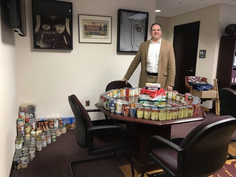 NHS collects record numbers in the Can the principal! food drive