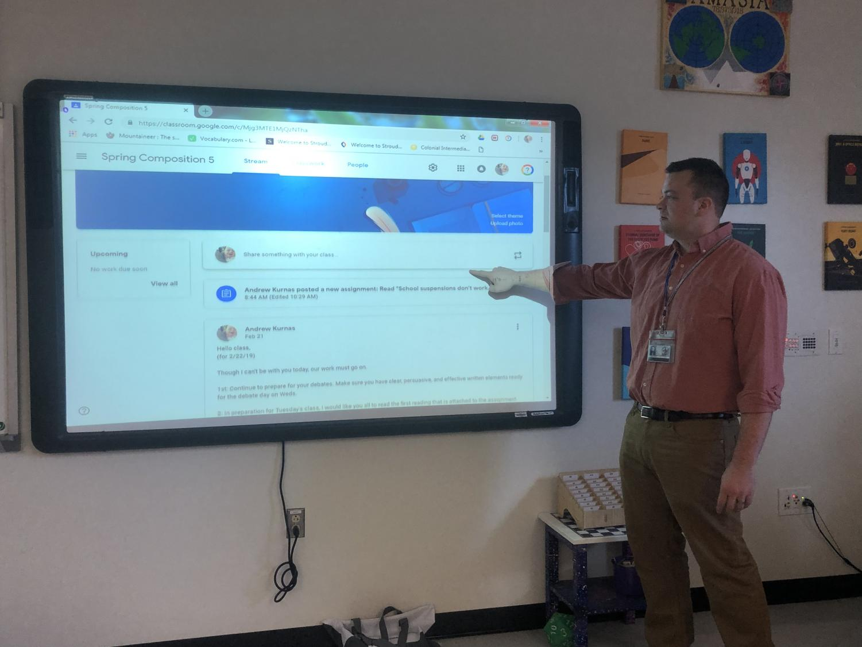 Mr. Andrew Kurnas going over a Google Classroom assignment.
