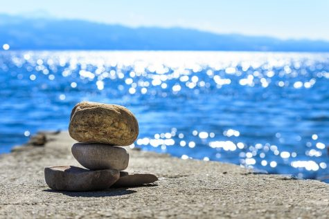 A view of the ocean with rocks finding a balance.