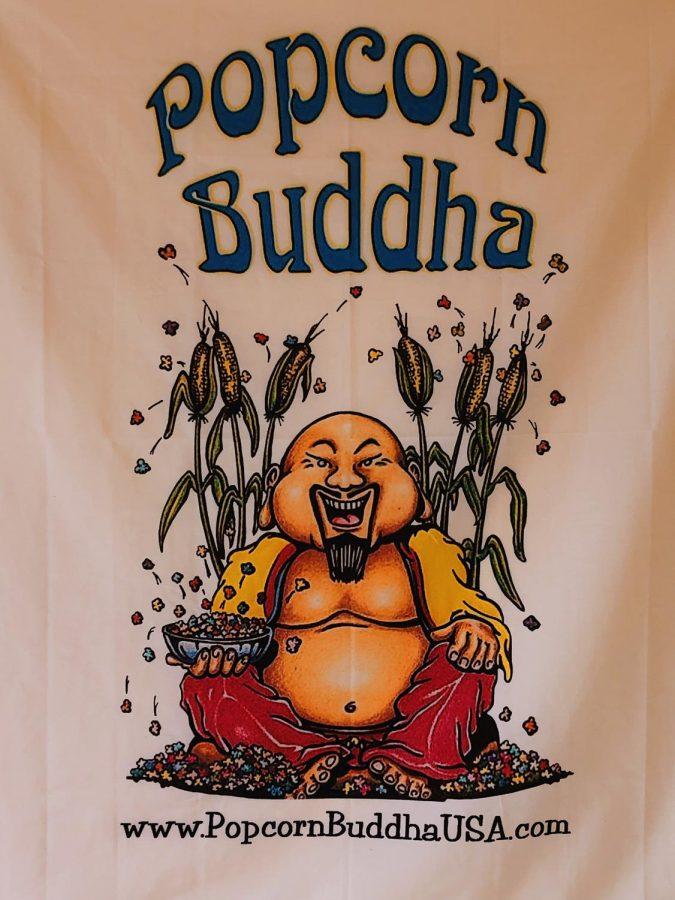 A poster hung at Popcorn Buddha.