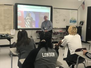 Social studies teacher Mr. Kurnas discusses a political event in the classroom.