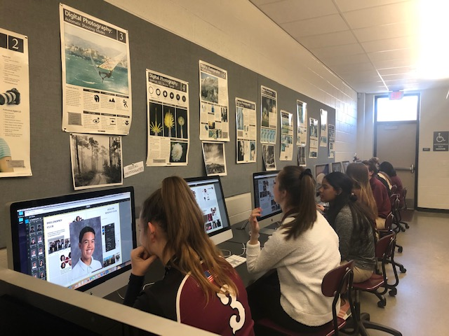 Students are working on the yearbook.