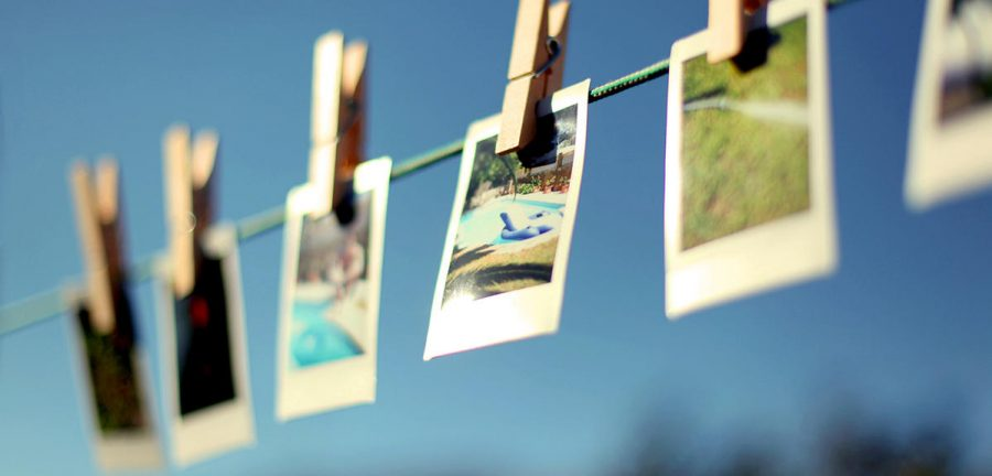 Summery+pictures+hanging+from+washing+line+using+clothespins.