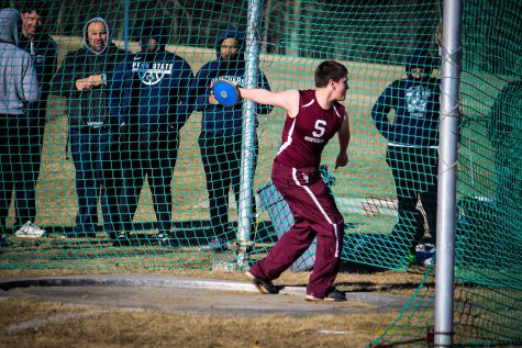 Junior Anthony Liguori throws discus in a track and field meet in April, 2019.