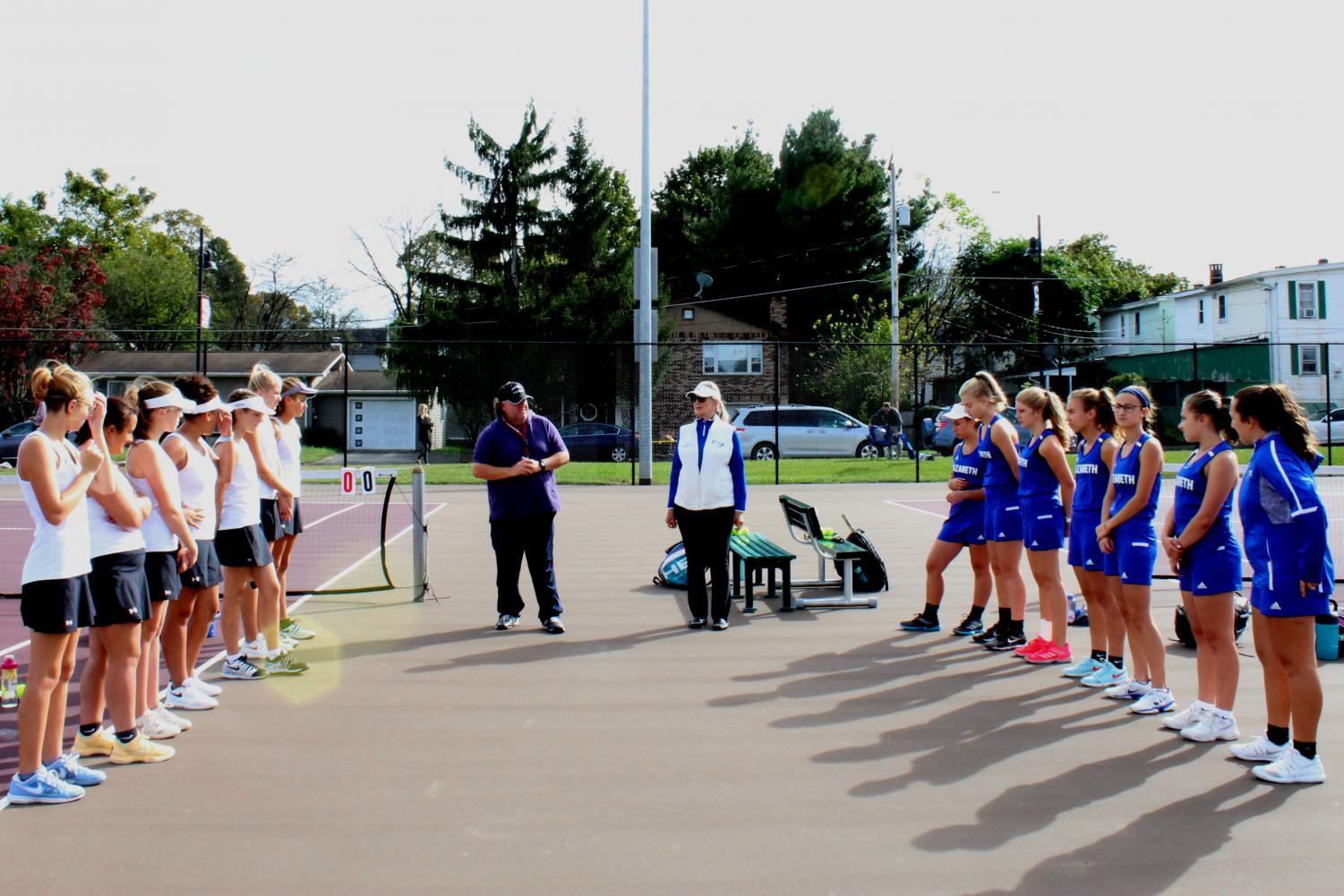 The girls' Varisty tennis team and Nazareth tennis team lining up to introduce each player and their position.