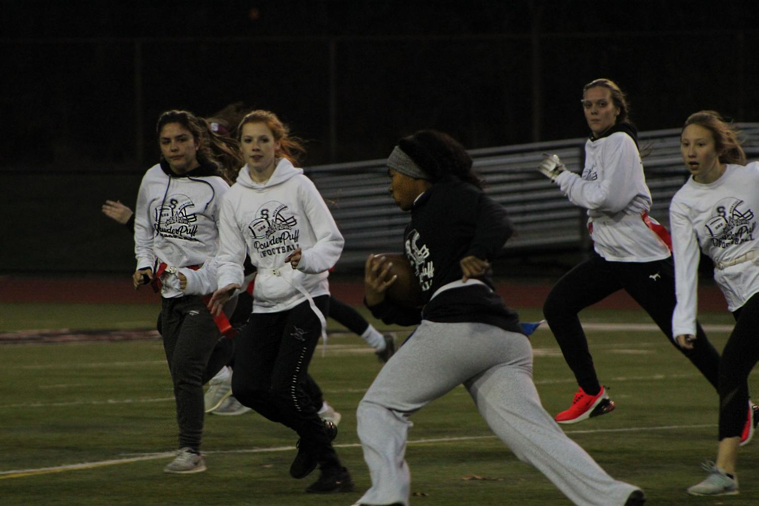 A shot taken during the Stroudsburg Powderpuff game in which girls get to play football.
