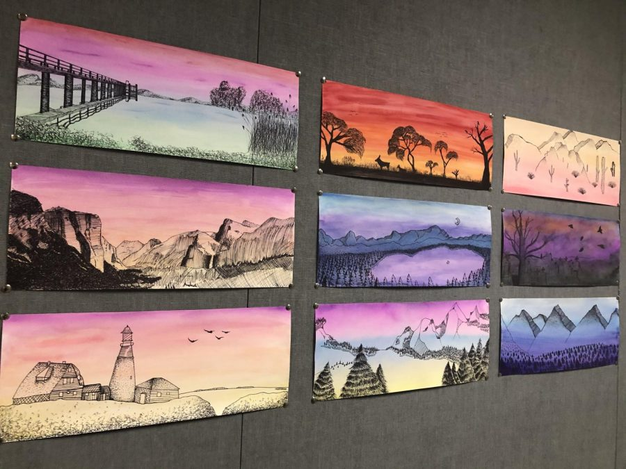Art Major 2 recently finished a panoramic watercolor project. The assignment had artists create a landscape with a colorful background and use sharpie markers to fill in the foreground.  As shown, the results are quite impressive. Find a chance to see the rest of the landscapes in the art hallway.