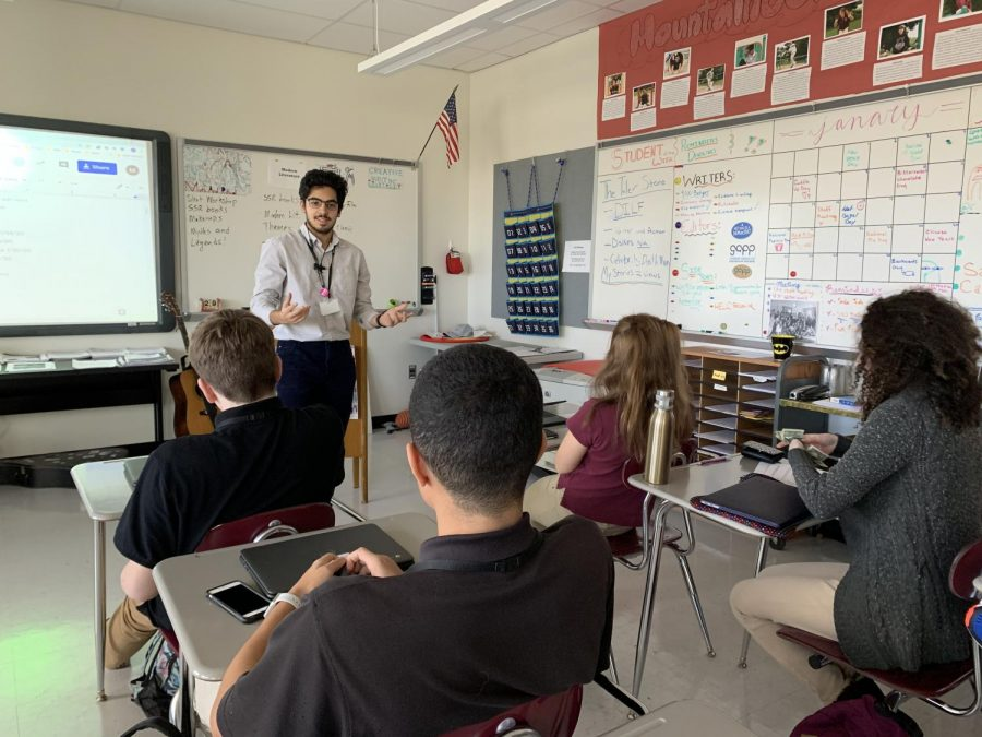 Taha Vahanvaty performing his poem in front of the Journalism class.