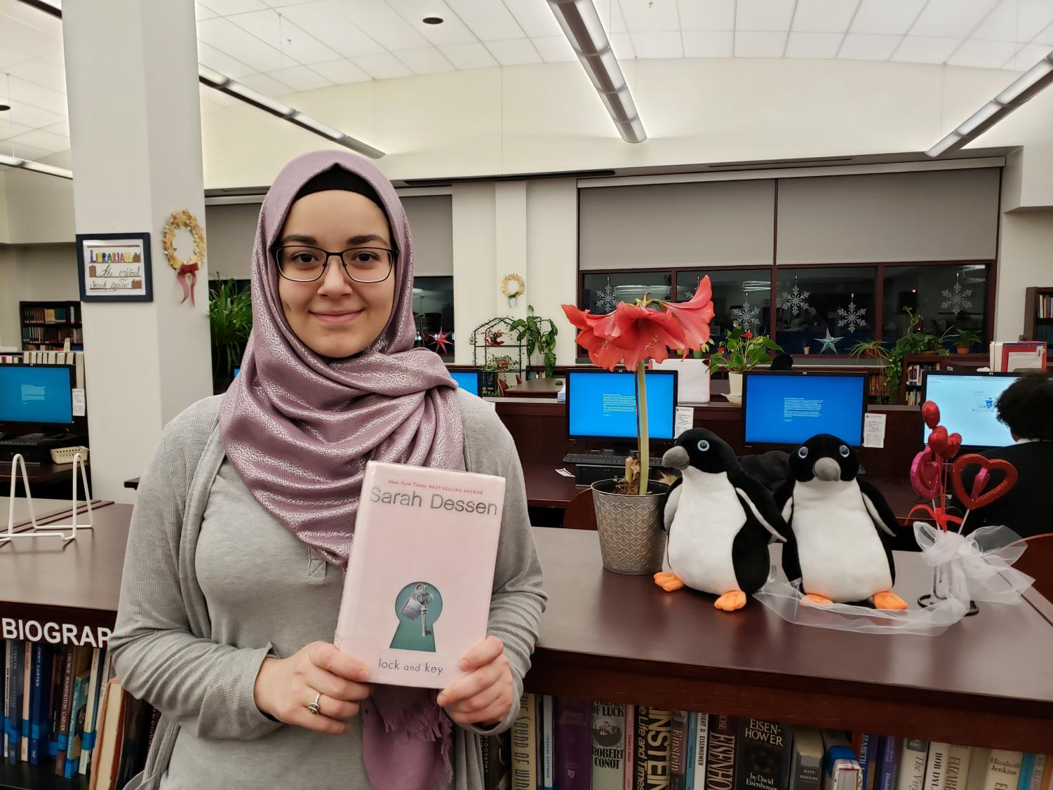 Picture taken by school librarian. Student holding her book recommendation