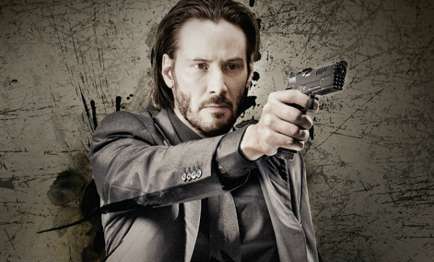 Photo+via+farefilm.it.%0AJohn+Wick+from+the+John+Wick+movies+holding+a+gun.