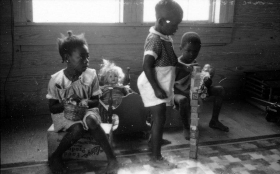 Black children playing with white dolls in 1937.