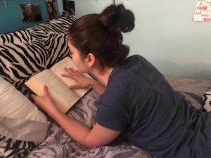 Freshman Mari Wendt conducts her morning routine, starting with reading her favorite book for twenty minutes.