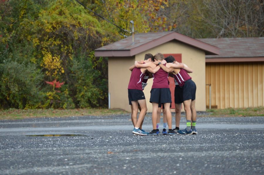The boys XC team prepare before the District XI Championship.