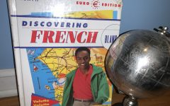 French 3 student's French textbook and globe.