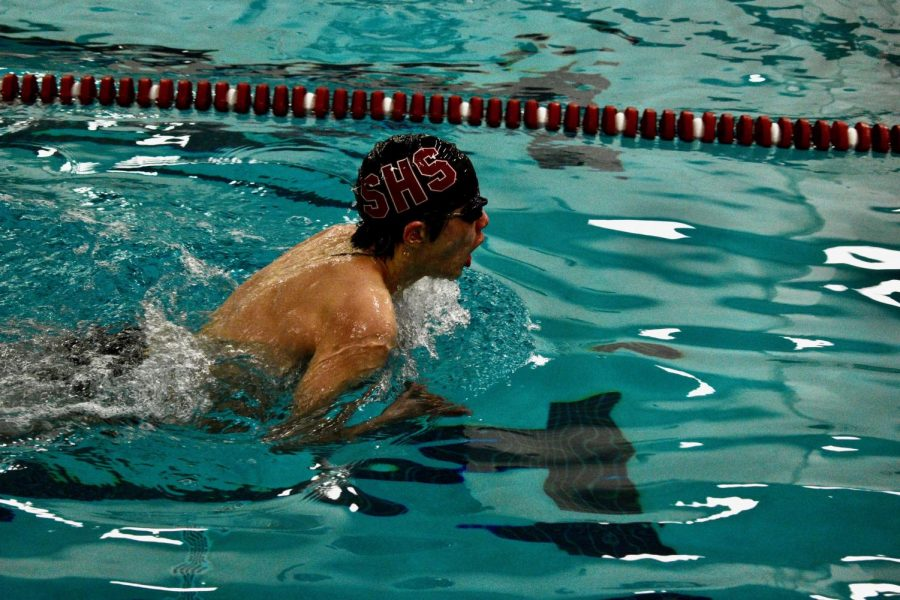 Sophomore Chris Hu competes in a varsity swim meet at Chipperfield Elementary School.