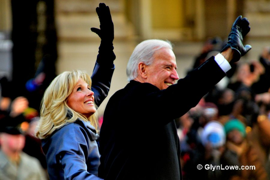 President Joseph Biden and his wife, first lady Jill Biden, are seen waving to supporter on inauguration day.
