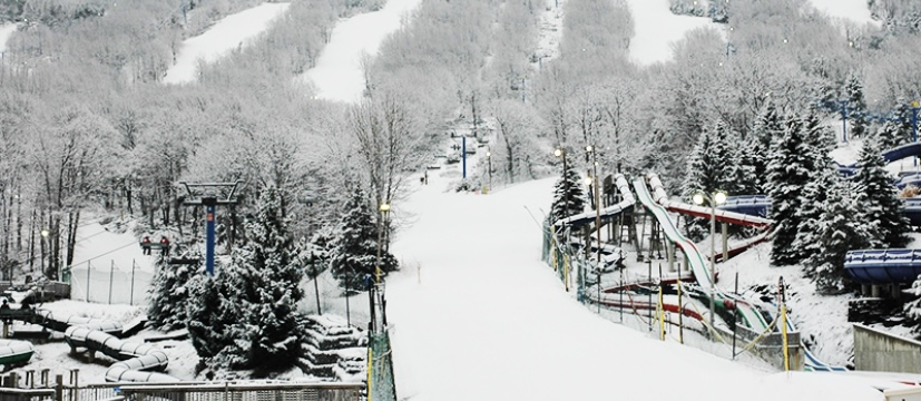 The mountains are covered in snow and are ready for skiers and snowboarders to hit the slopes.