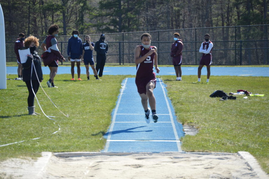 Sophomore Darian Henry competes for Stroudsburg in a jumping event at Pocono Mountain West.