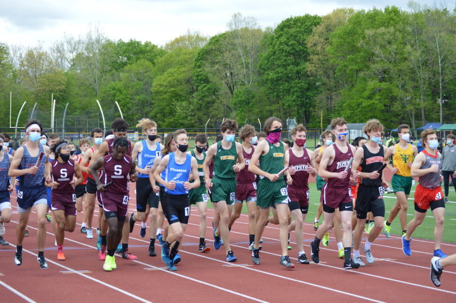 Multiple teams make their way to the start line before the boys 4x800m relay at the EPC Championship.