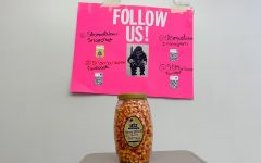The jar of candy corn is pictured, along with the Mountaineers social media information.