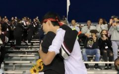 Chris Hu and Bella Snyder during Chris homecoming proposal at a Friday Night Football Game.